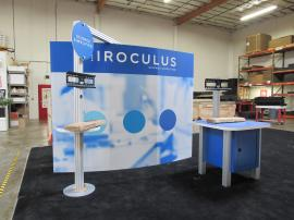 Modified Gravitee GK-1011 Modular Exhibit with Tension Fabric Graphics, Monitor Kiosk, and Custom Product/Workstation with Storage