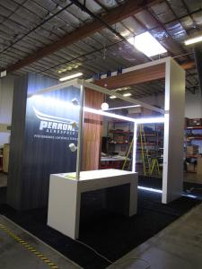 Custom Island Exhibit with Powder-coated SuperNova Lightboxes, Laminated Tower and Closet, Puck, Pendant, and Track Lighting, Shelves, and Genius Bar